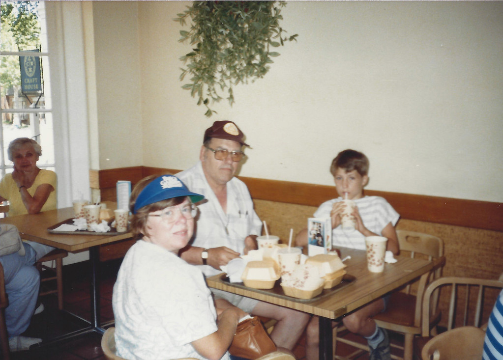 Mom, Dad, and my neighborhood friend Donald having a bite to eat during a vacation trip.