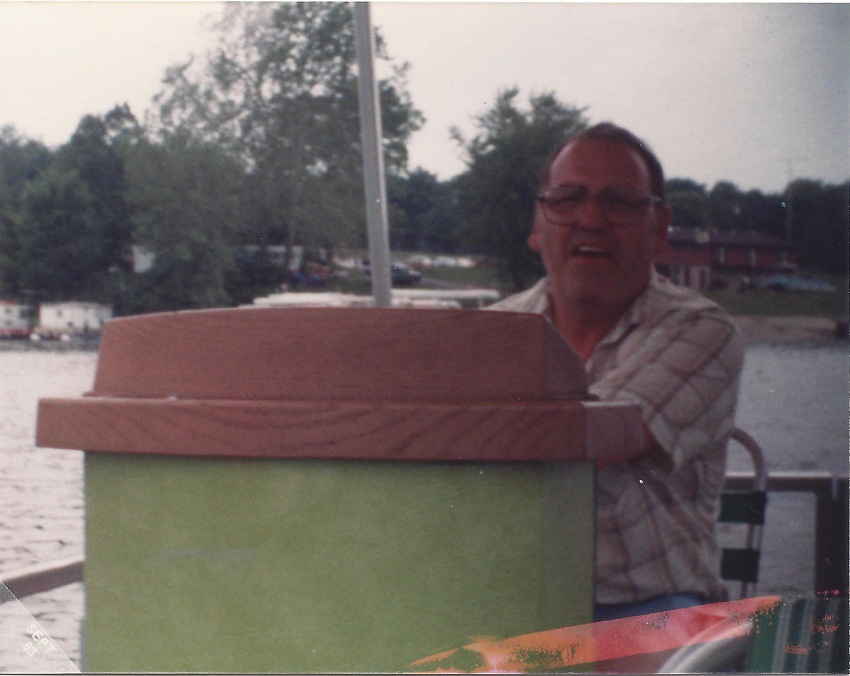 Dad captaining a pontoon boat for the family