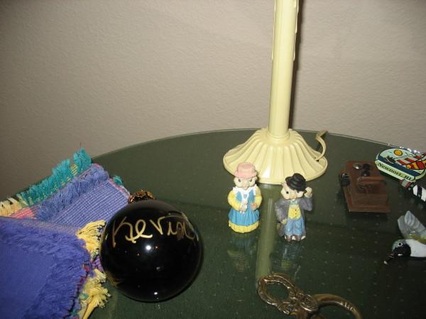 Napkins, Kev's Christmas ornament, electic window candel, claddaugh door knocker