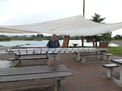 Rotarian Doug was determined to adjust the new awning as a rain squall descended upon us.  He finished just as the rain and wind abated.