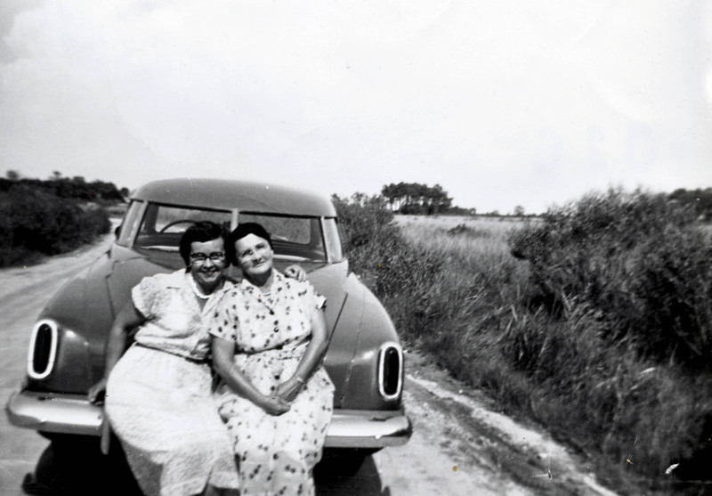 Ladies on a car, road to Crocheran?   <br /> <br /> Can you name who the ladies are?