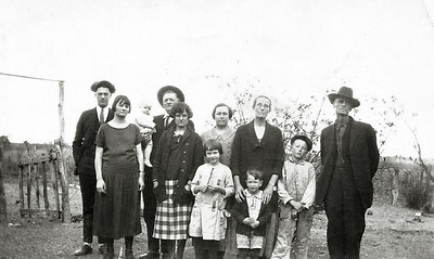 "ALFRED AND CORA SMITH FAMILY L-R, (Lois's husband, Dan?), Lois, Alfred Joseph ""Papa"" Smith holding baby (Mac?), Myrtle, and Cora (Barron) ""Mama"" Smith.  The others and young children are kinfolks of some kind."
