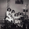 "BARBARA CAROL ""BOB"" AND LISA SCARBOROUGH <br /> Duncan home, Grand Prairie, Texas - 1957<br /> <br /> Our next-door neighbor holding her little girl at Doug's birthday party. I wish I could remember who the little girls are. I'm sure they're neighborhood classmates of mine."