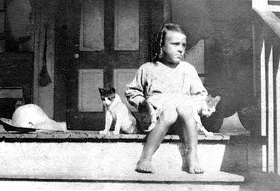 ADDISON REID Addison Reid on the front porch with cats - 1908