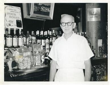Joseph Moran working at his brother John's bar