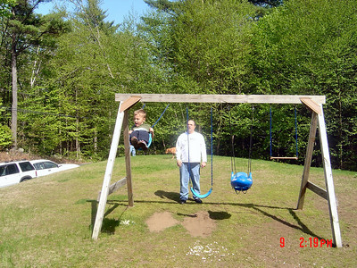 Ty_and_his_Great_Uncle_Chuck_play_on_the_swings
