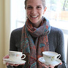 Laura Ann Sweitzer holds up two different tea cups - one from each of her deceased Grandmother's tea services ( Marie Grace Eikenberry Sweitzer & Anna Ruth Neff Haynes).  Laura's visit was a total surprise for her Mom Sarah.