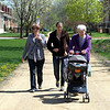The women head out for a stroll (Ruth gets the deluxe layback and/or nap while you stroll version). Note that the brisk morning strollers are wearing coats and jackets.