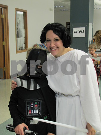 Erin Guddall with her son Sam 'Darthvader' at the 'Night with My Hero' held at Citizens Central.