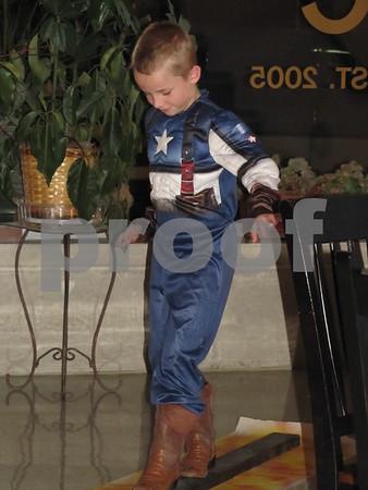 Evan Pratt 'Captain America' demonstrates his agility at the 'Night with My Hero'.