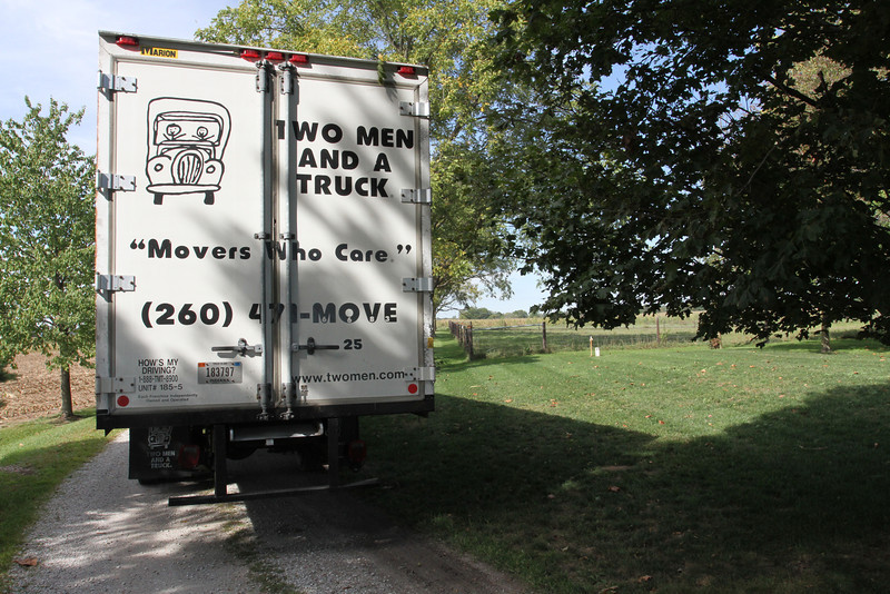 """""""Two Men in a Truck"""" arrives backing in the lane."""