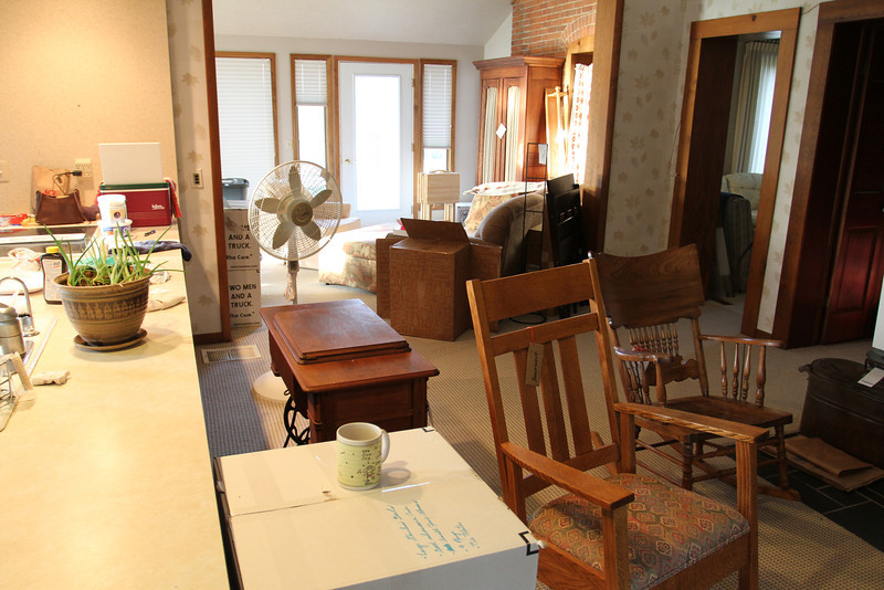The most lived in space in our country home, now becomes the staging area for many boxes and antiques.