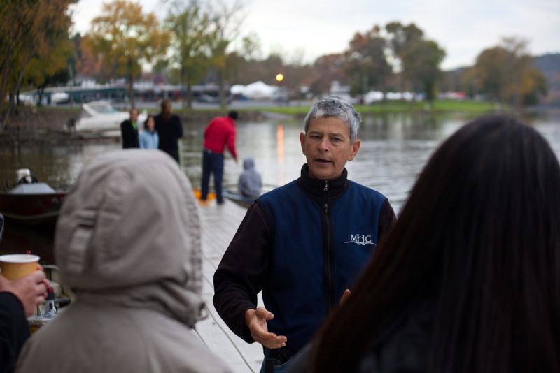 The Mt. Holyoke Head Coach Jeanne Friedman talking to parents on the dock.