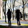 Walking back towards her dorm.