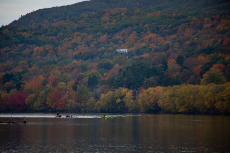 The setting is beatutiful.  The two freshman boats round the bend in the river rowing upstream.