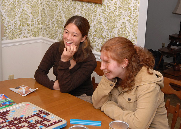 Sophie and Gretchen gloat over a crushing defeat of Tom in a Scrabble challenge.