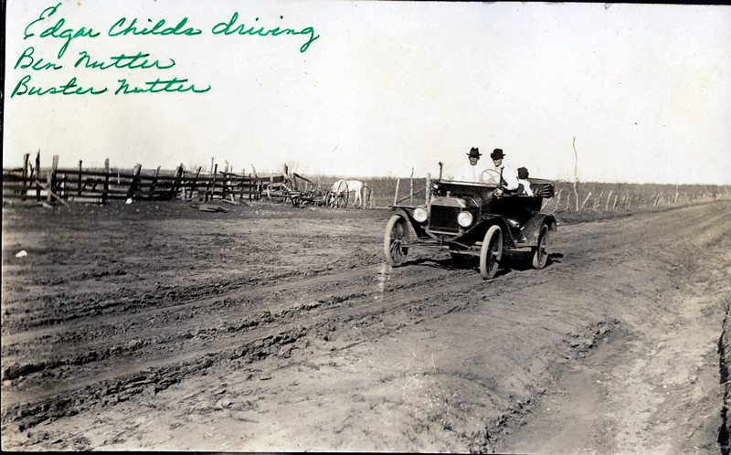 Edgar Childs driving, with Ben Nutter and Buster Nutter