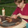 Lydia building her guitar for senior project - Clamping the kerfing