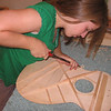 Lydia building her guitar for senior project - Shaping the braces