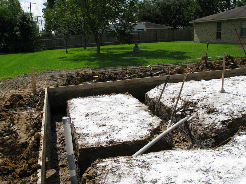"""The base for the vault. Beams are 30"""" deep with 10' piers on two corners and 12"""" of concrete across."""