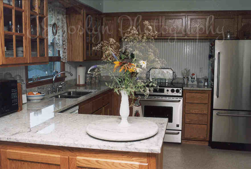 Kitchen Remodeling Result - 2001.  All new, bright, and open.  I am so pleased with all my choices, and the contractors work.  Yup, freezer on the bottom!  Only way to go.