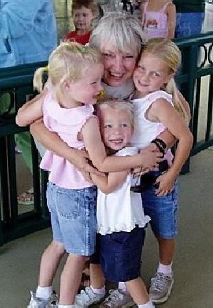 Group Hug Time.  G 4 1/2, C 2 1/2, P 6, and me, taken at Cafestian's Carousel, Como Park, St. Paul, Minn., summer 2004.