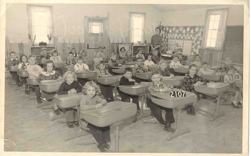Osseo, Minnesota, Osseo Public School, 1st Grade, I'm in the front seat, 1st column.  Mrs. Sherrard, 1949-50 School Year.  I believe this was the only room for First Grade, plus almost everyone in the photo graduated as Seniors from this same school, Osseo High School, Class of 1961.  Isn't that amazing?