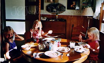 P, C, and G, summer 2005, breakfast at Grandma Hat's.