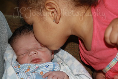 RJ and sister - visiting with him at 1 week old, born May 9, 2009.