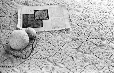This is a crocheted bed spread 99.99% completed by my mother, but after she died I am finishing it.  Notice, she had finished all but two of the motifs, and even had them all sewn together.  I have one of the two done, and need to start the last one.  Then there's a fringe that goes around it, probably on three sides.  What a challenge, but truly beautiful.  Color is ecura.