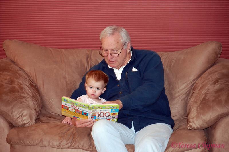 Sabrielle enjoying a story with Grandpa