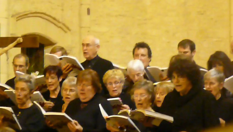 Video of my mother singing in a choir in France during a performance of them.