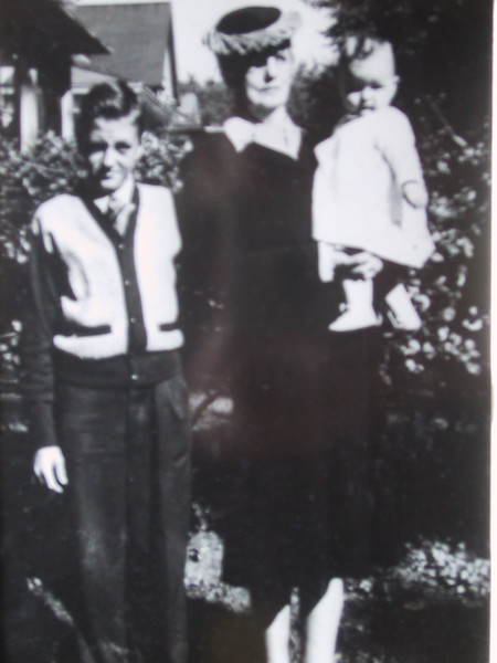 Photos of photos, before scanners were available to the laypeople, <br /> <br /> This is my dad, my great grandmother Peterson, and my aunt Mary Ellen. circa 1947
