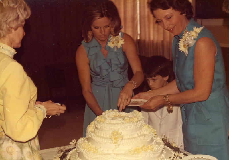 Shirley McKee, Betty Freeman (my aunt, see other folder), Brad Freeman, and Nanelle Adams getting cake at reception