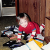 Sept. 1987<br /> 262 Marich Way, Los Altos, Ca<br /> Cindy (13 months) emptying the VCR tape cupboard.