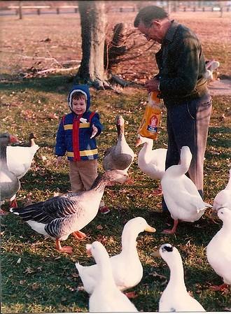 Edward III - age 3 & his Granddaddy feeding geese & ducks in NJ 11/80