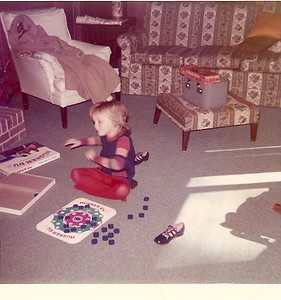 Caroline playing Husker Du - her favorite game at the time - around 6 yrs