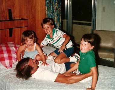 roughhousing with Uncle Tom - Bridget, Edward III and Catherine - Summer '84