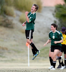 On his high school team, Chris plays the field, usually defensive mid.  But with the game on the line, he pushed forward and put in the game tying goal with literally seconds to go.  His expression says it all.  Winter 2013