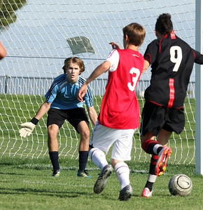 Chris playing goalkeeper with Arsenal FC B95 White playing in the National Cup tournament (Lancaster, CA, 4/2012).