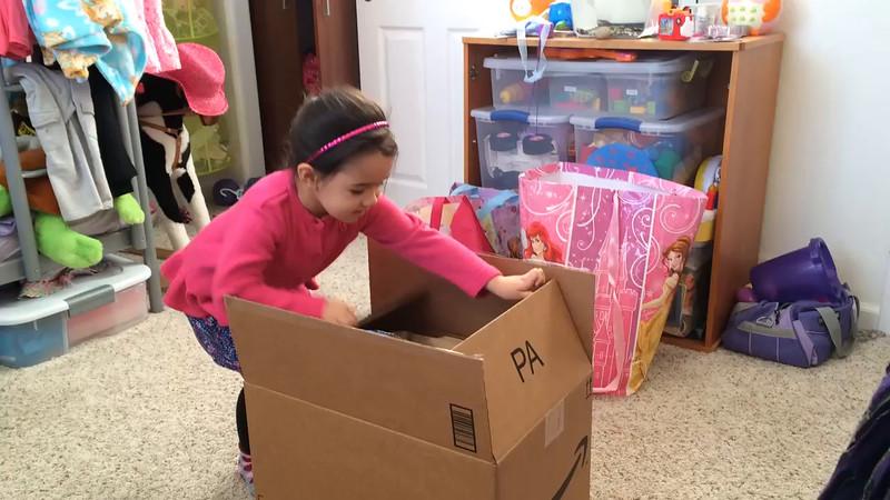 Myriam opening her 4th birthday gift from Devin, Shana & Josie.