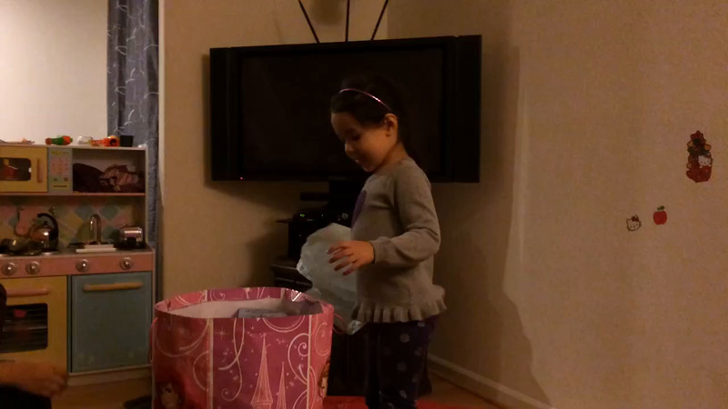 myriam opening her 4th birthday gift from mala.