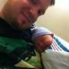 sleeping in daddy's arms for the first time.<br /> <br /> sorry for the crappy resolution - this is from the iPhone4's front camera.