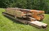 Rough-sawn beams and rafters. Red Oak, Locust, and Hemlock from Bee Tree Hardwoods. Used for the exposed framing members of the cabin.