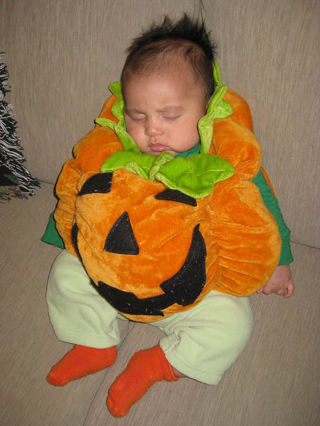 Sleepy pumpkin baby is unaware of the exploitation his parents have put him through