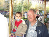 Great Uncle Kerry and Nolie a little dizzy on the carousel.