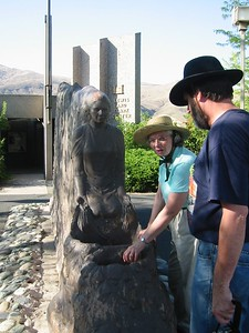Nancy explains to Ken how the water will flow in the restored sculpture.