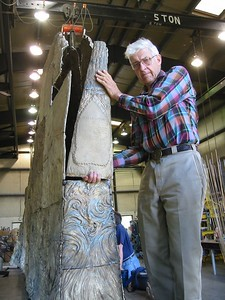 Brude holds up the panel that labels the sculpture: Tsceminicum. Tsceminicum is a Nez Perce word meaning 'the meeting of the waters.'  This sculpture will be installed in Lewiston, ID at the confluence of the Snake and Clearwater Rivers. (It will replace an earlier concrete version Nancy had created in 1978-79.)  More photos of this scupture.