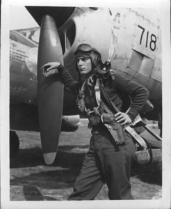 Col. Phillip Owen Robertson leaning on the prop of his P-38