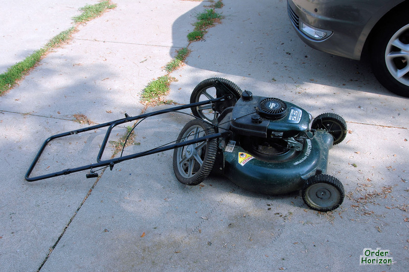 Dead lawn mower, hit by a car